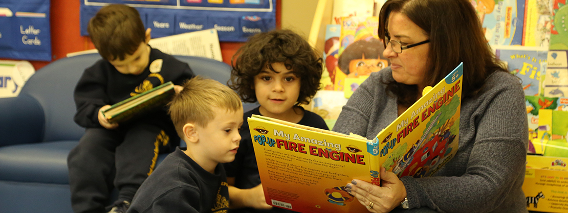 teacher reading story to students